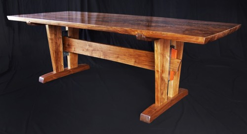 The Cain dining table made of walnut, bloodwood and steel.